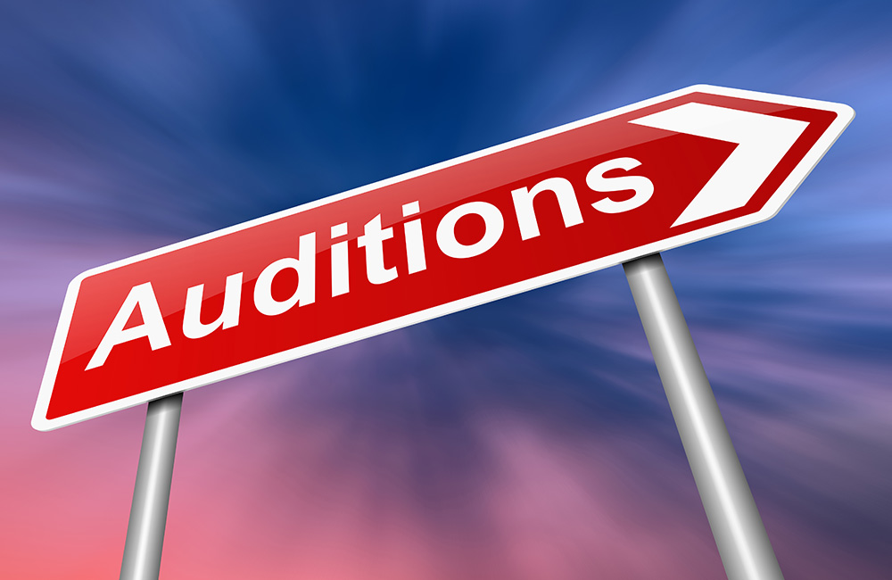 Road sign arrow pointing toward auditions