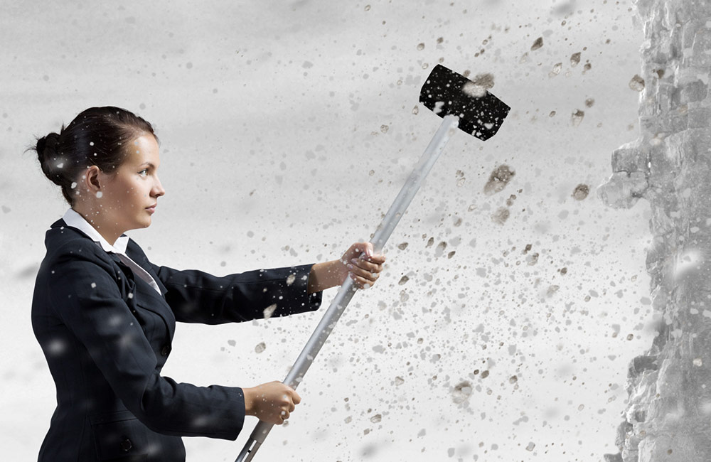 Woman swinging sledge hammer