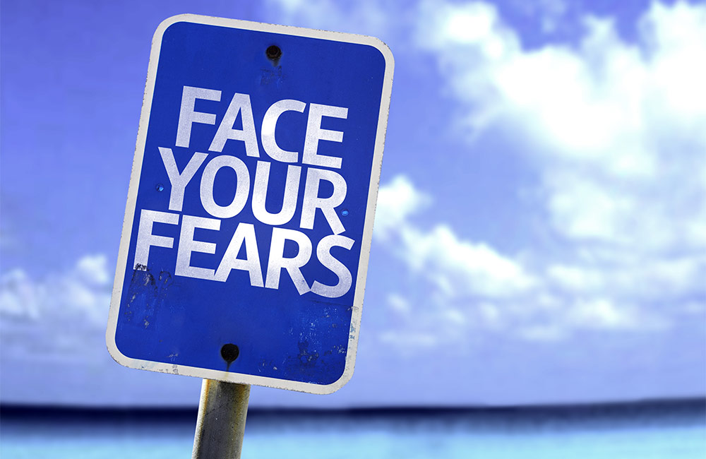 Face your fears typed on sign