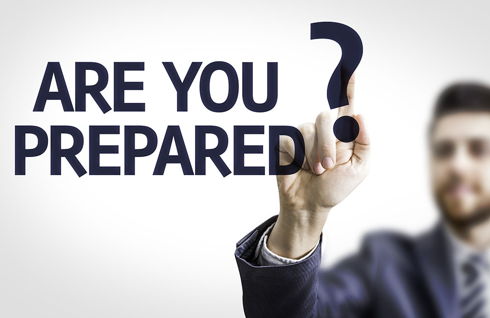 A man writes the question, Are you prepared?