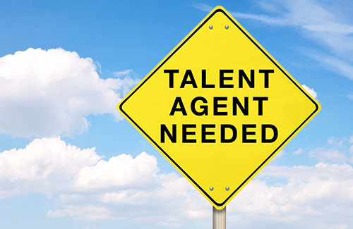 A street sign saying Talent Agent Needed