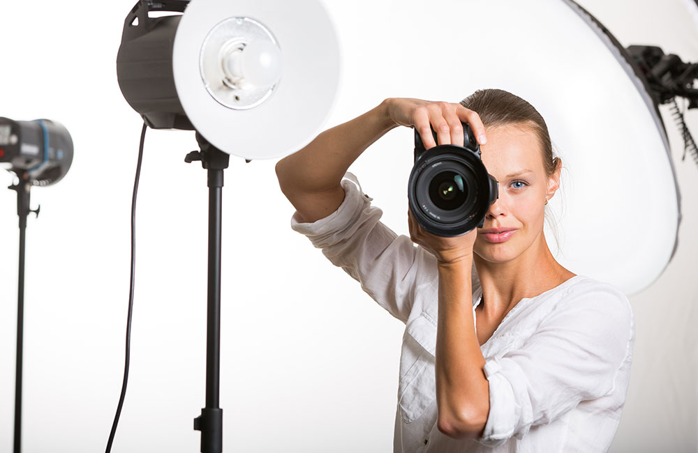 A photographer shoots photos in her photo studio